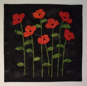 poppy-pa-svart60x60